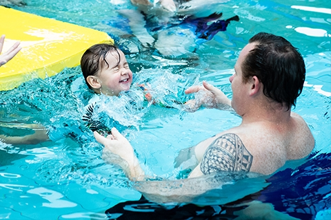 Dad and child swimming at H2O Xtream Aquatic Centre